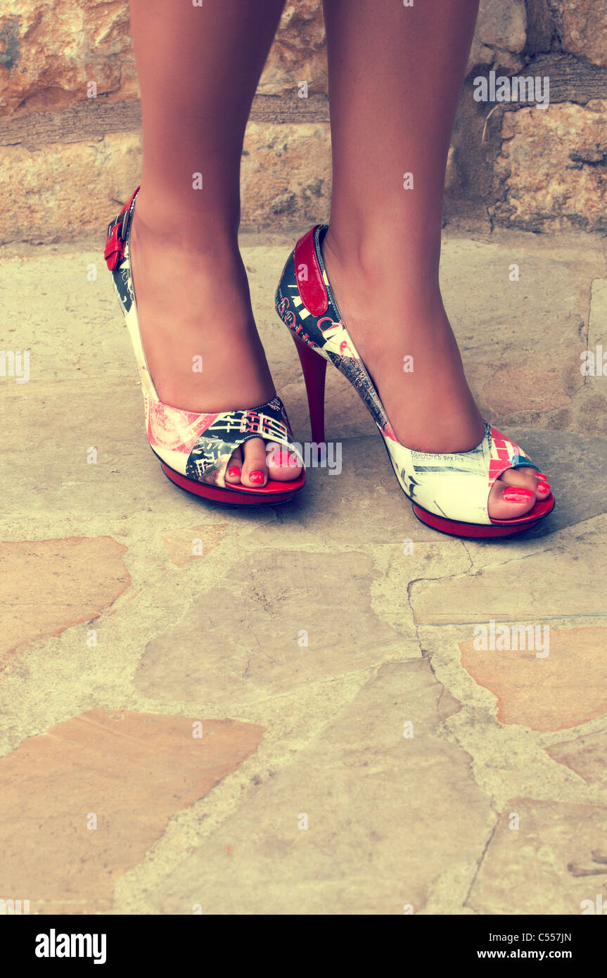 Woman's feet with high heels - Stock Image