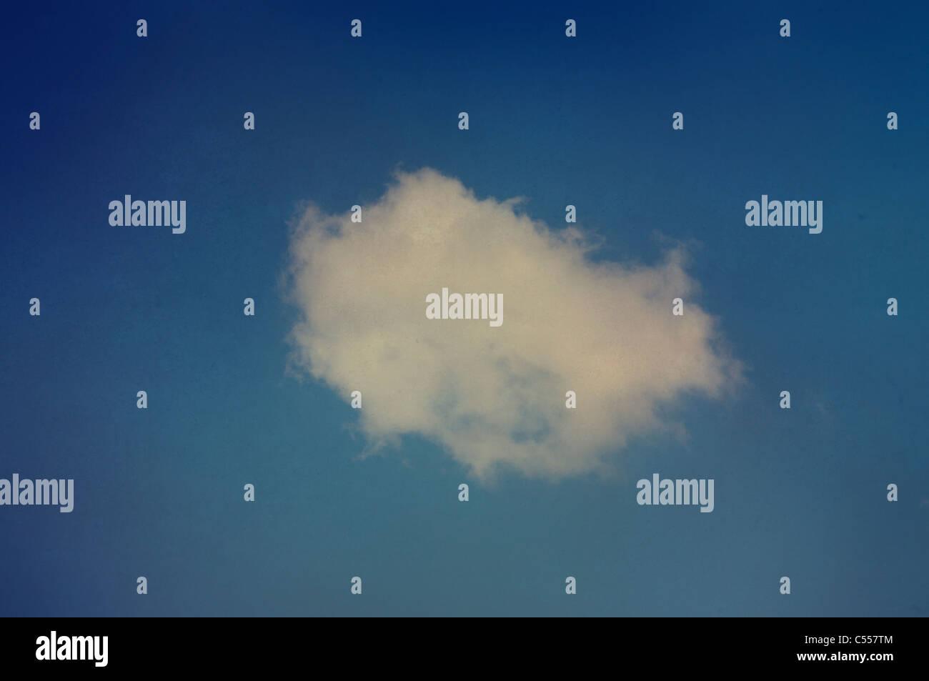 Single fluffy cloud - Stock Image