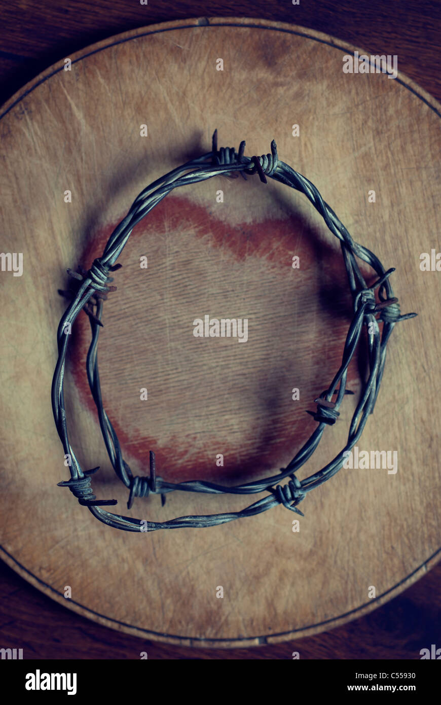 old barbed wire over a heart shape - Stock Image