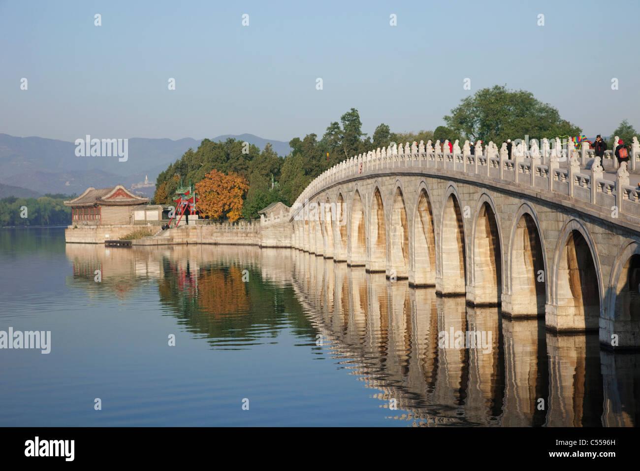 Arch bridge across a lake, Seventeen-Arch Bridge, Kunming Lake, Summer Palace, Beijing, China - Stock Image