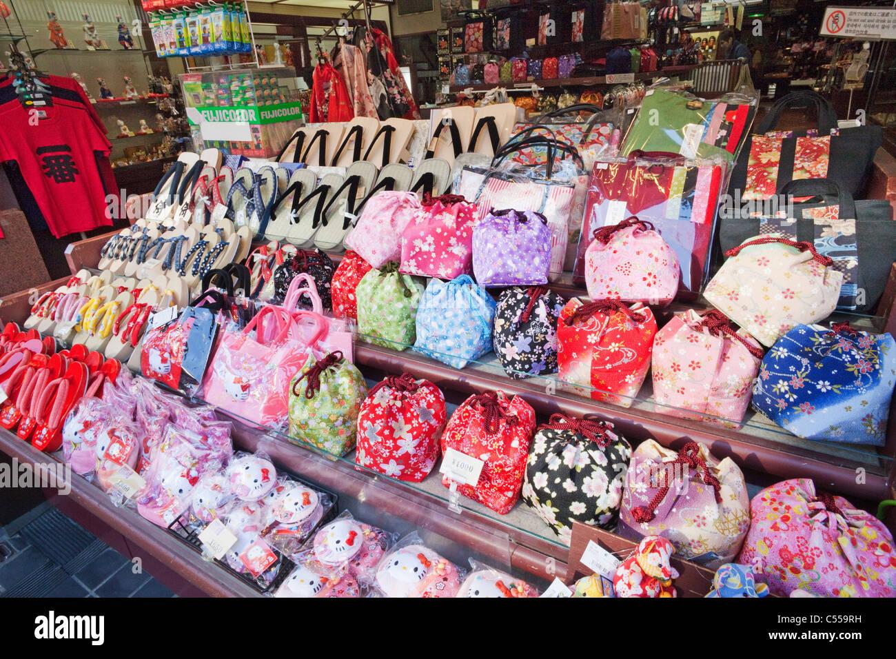 Hand bags and sandals displayed at a store, Higashiyama Ward, Kyoto Prefecture, Kinki Region, Honshu, Japan - Stock Image