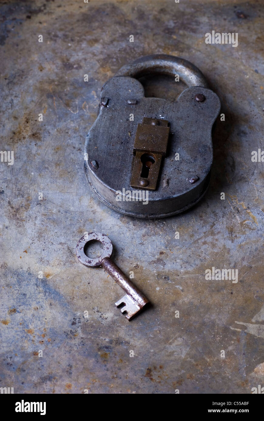 Old padlock with a key - Stock Image