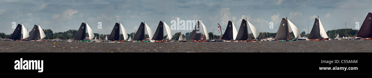 The Netherlands, Elahuizen, Sailing races called: Skutsjesilen, with traditional flat-bottomed cargo boats called: Stock Photo