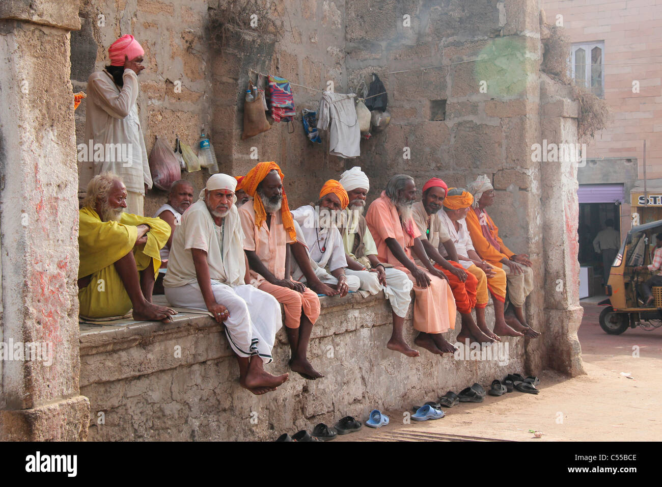 A group of Sadhus ( saints) sitting together in Dwarka temple, Gujarat,India - Stock Image