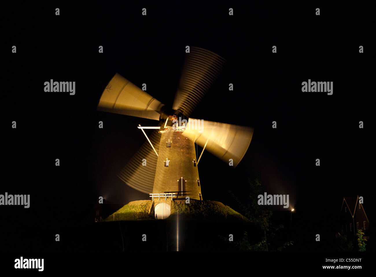 The Netherlands, Bredevoort, Windmill at night moving in floodlight. - Stock Image