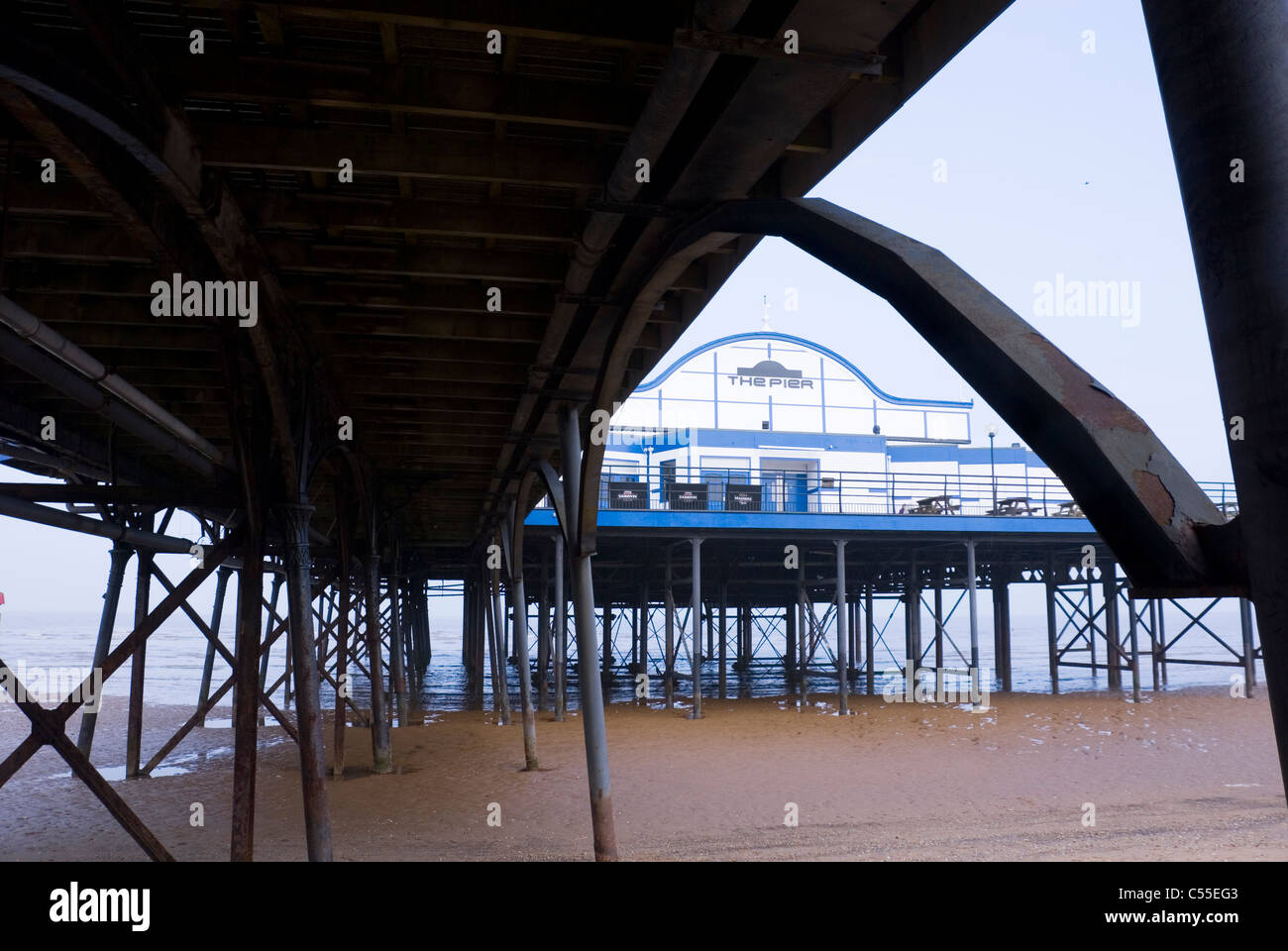 The Pier, Cleethorpes, Framed by Structural Support Steel Arch from Beneath the Pier, South Humberside, UK - Stock Image