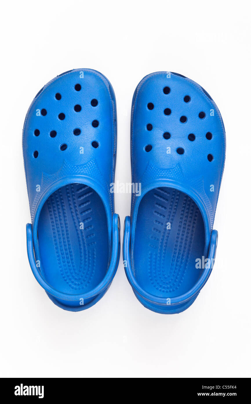 24f22ba66 Top down of a pair of blue Crocs plastic sandal shoes cut out and isolated  on a white background from above.