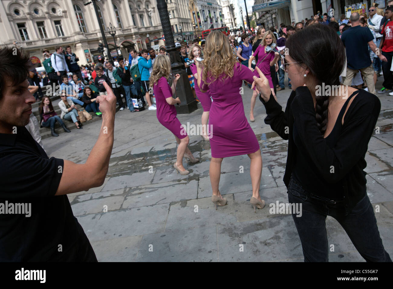 musicians dancers piccadilly circus london - Stock Image