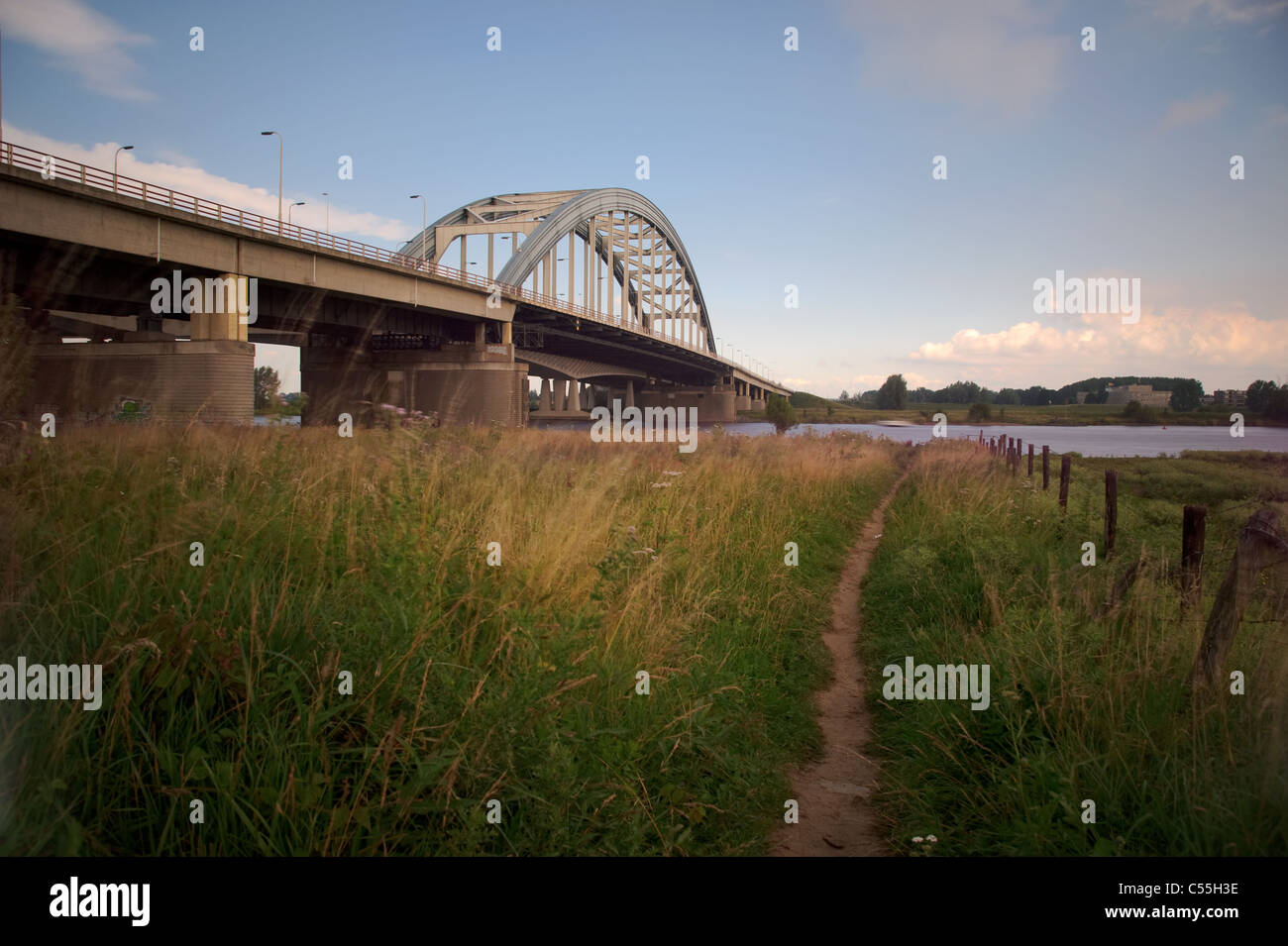 Bridge crossing river Lek with footpath in front - Stock Image