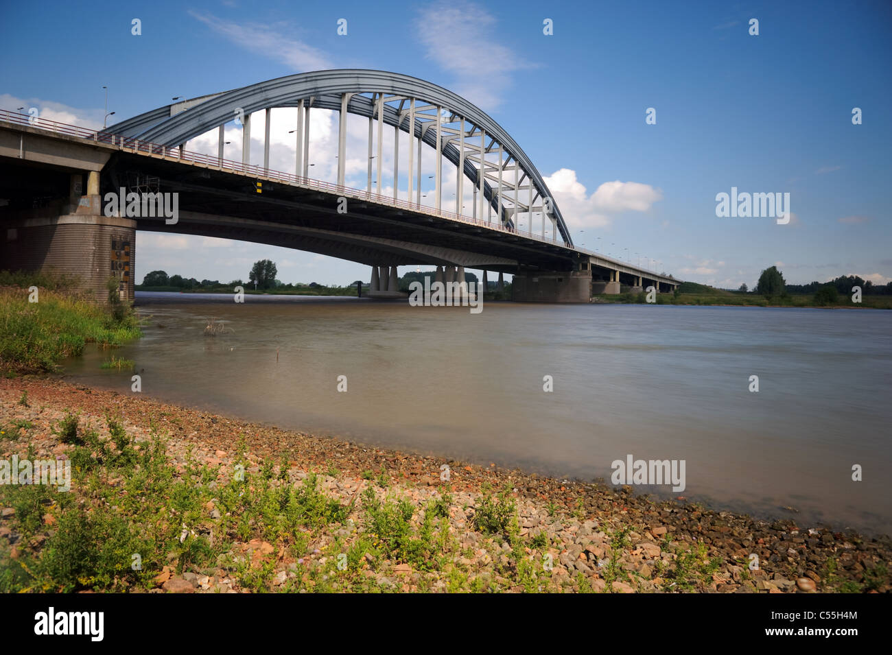 Bridge crossing river Lek with shore in front - Stock Image