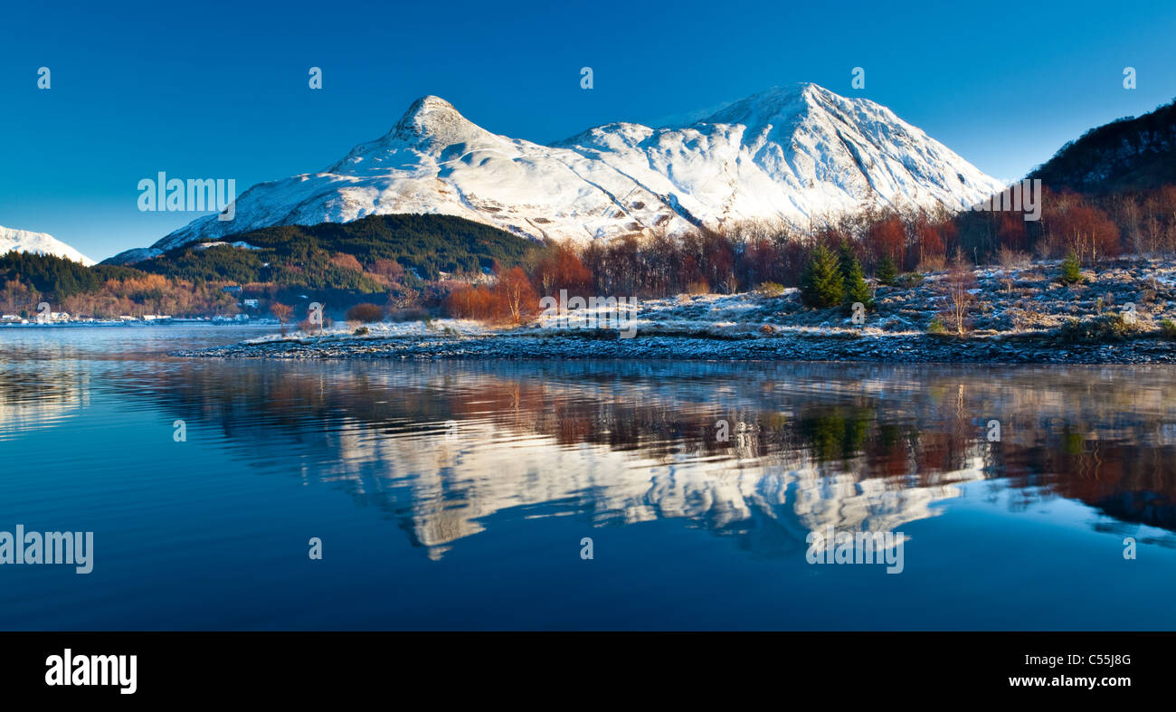 Scotland, Scottish Highlands, Loch Leven. The Pap of Glencoe (Sgorr na Ciche) reflected in the still waters of Loch - Stock Image