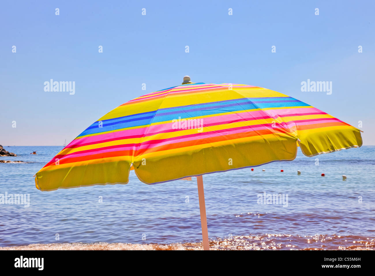 a parasol in the sun of Italy - Stock Image