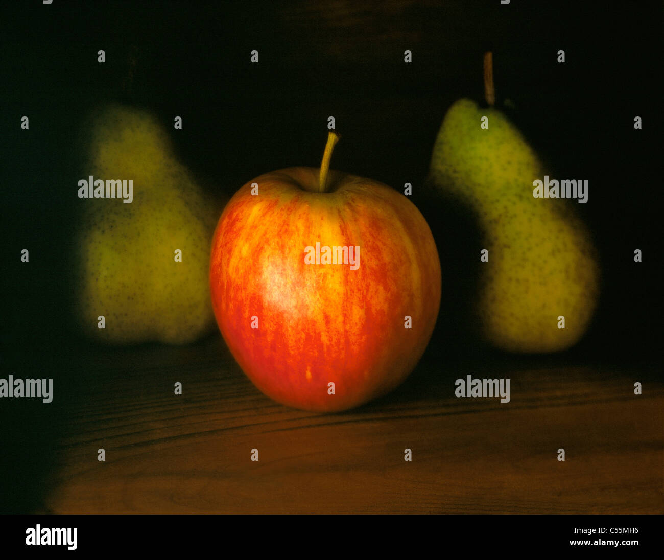 RED APPLE WITH TWO PEARS - Stock Image