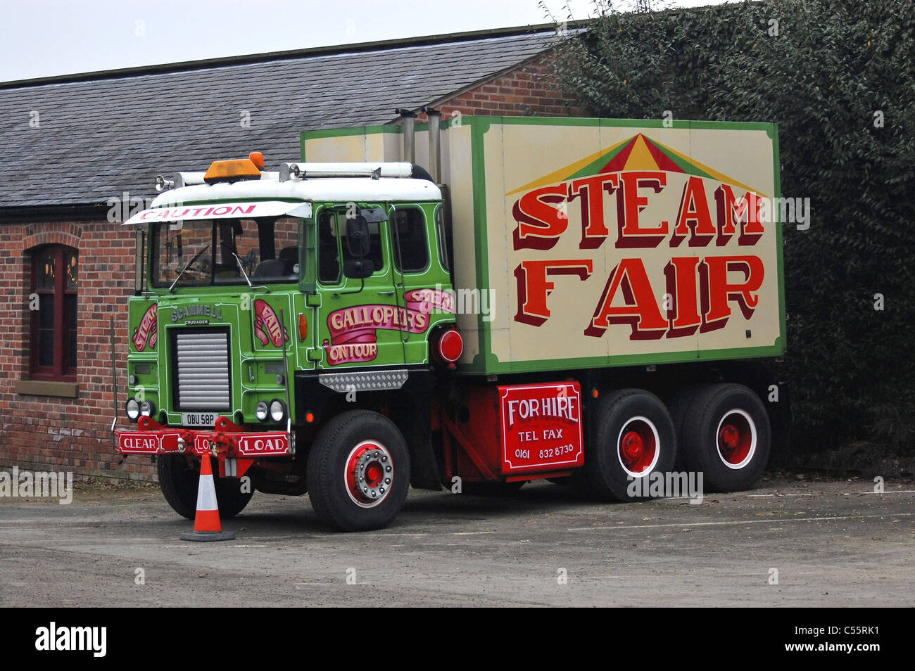 A power generating truck used to supply fairground ride - Stock Image