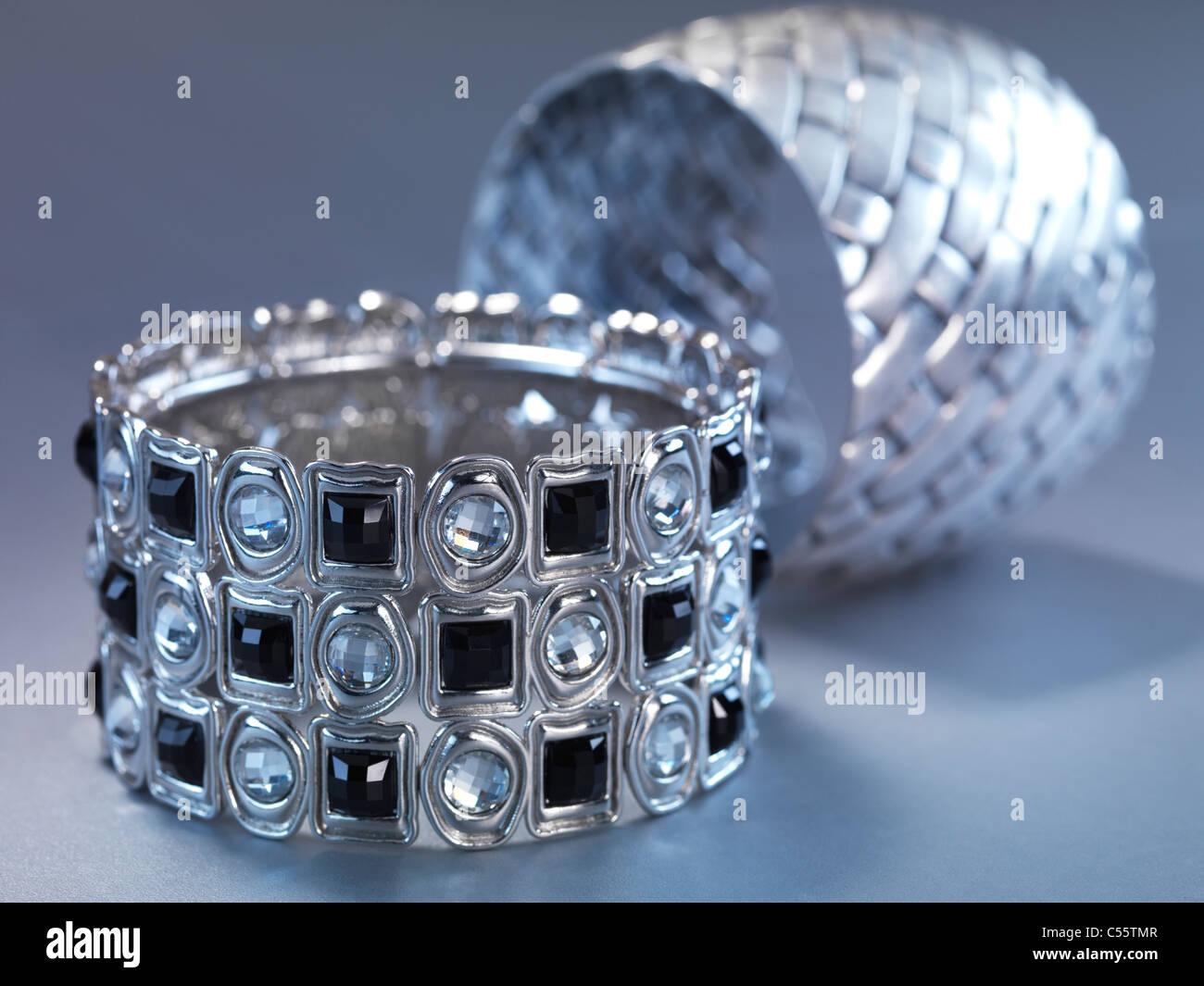Two bracelets jewellery isolated on gray background - Stock Image