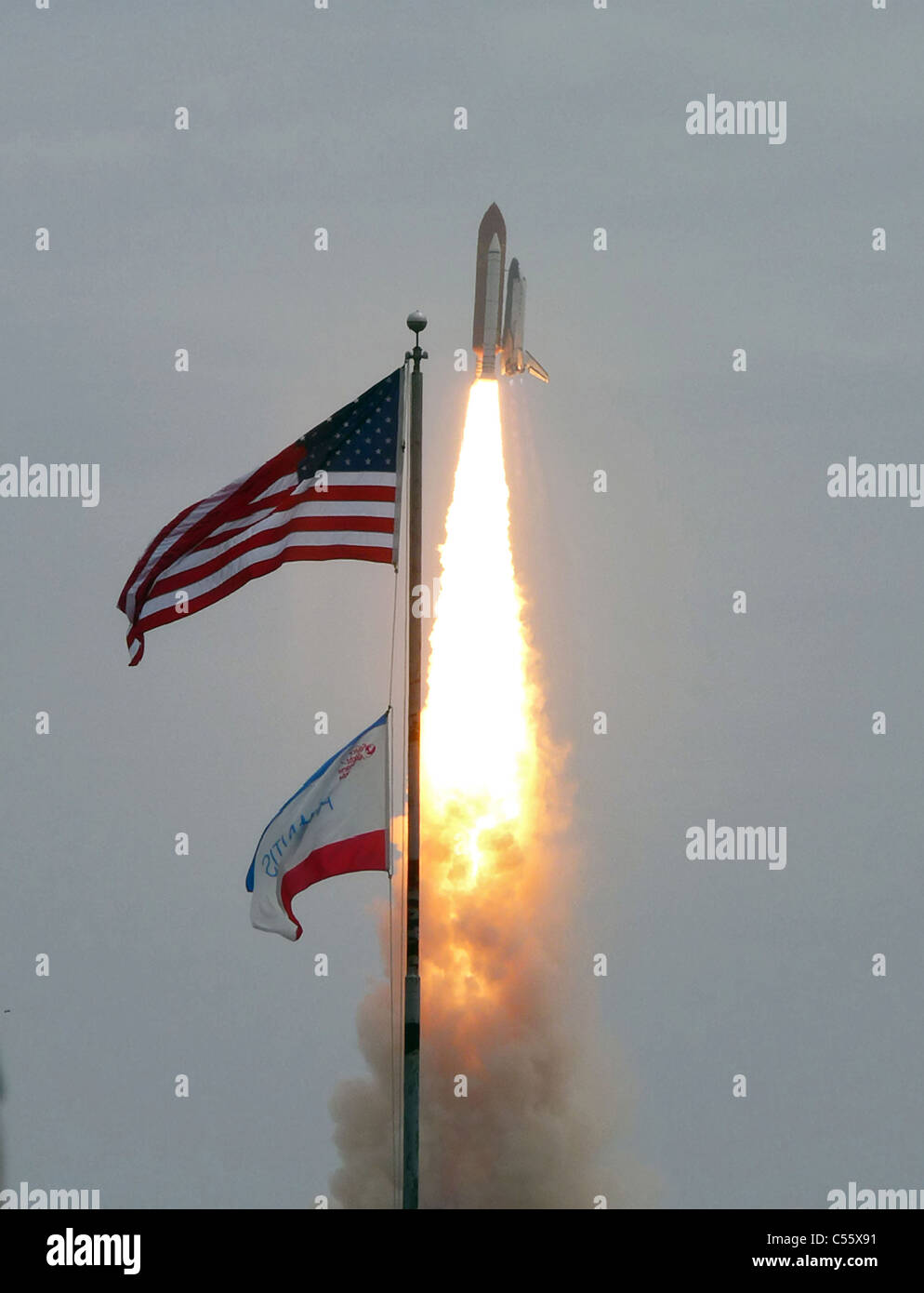 Atlantis STS-135 lifts-off on the final space shuttle mission at NASA's Kennedy Space Center in Florida. - Stock Image