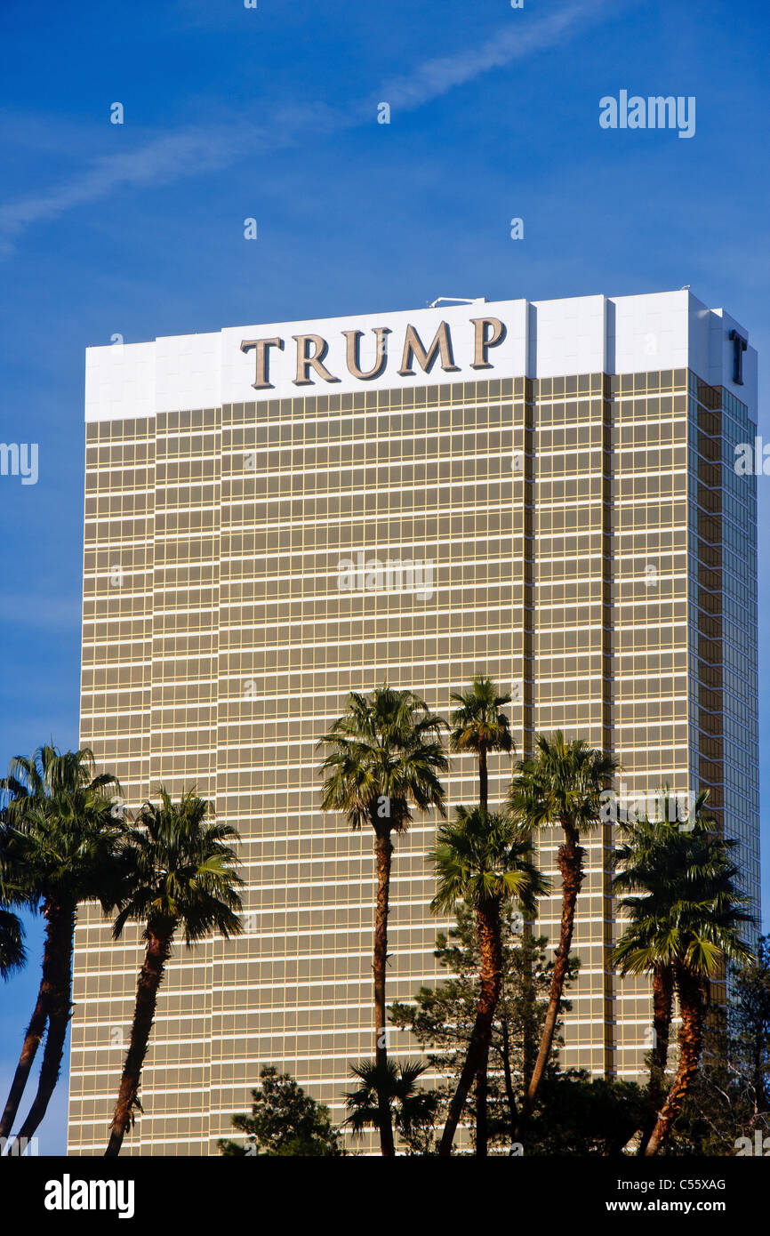 The Trump Tower in Las Vegas under blue skies beyond palm trees Stock Photo