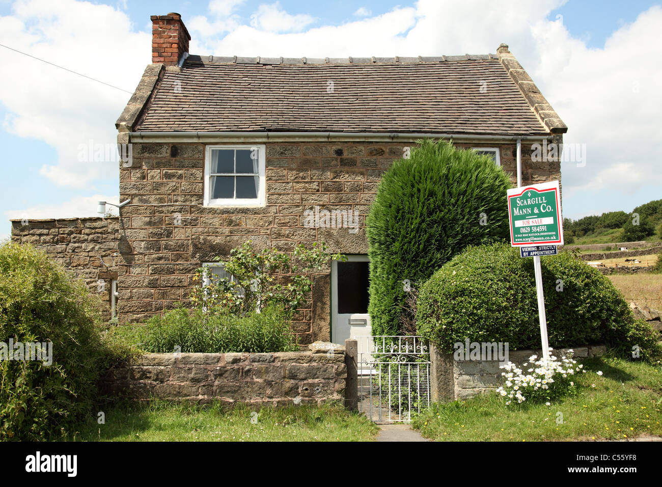 A cottage for sale and advertised as having holiday home potential in Derbyshire, England, U.K. - Stock Image
