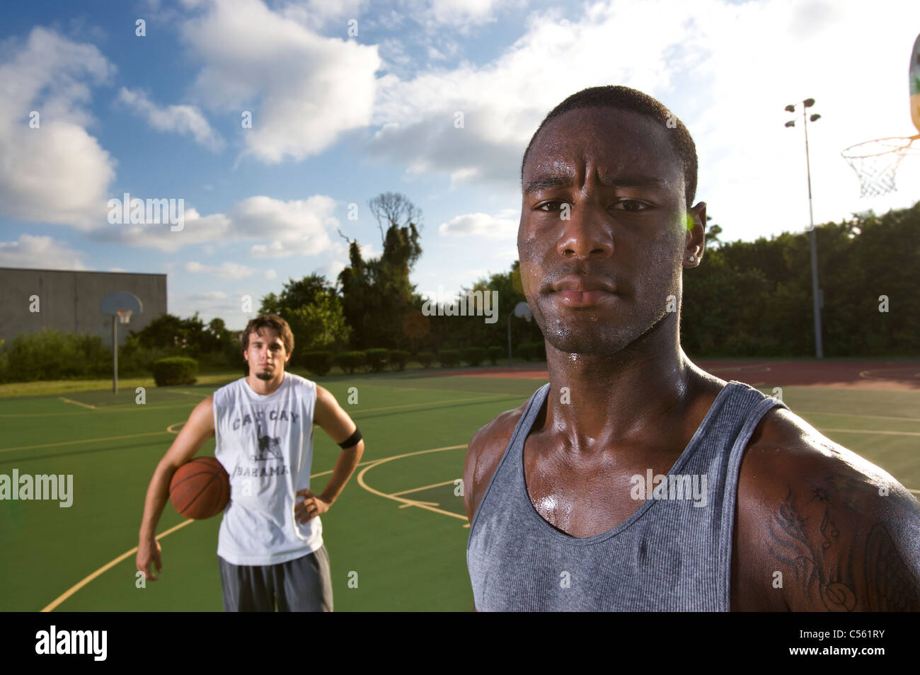 young males on outdoor court basketball - Stock Image
