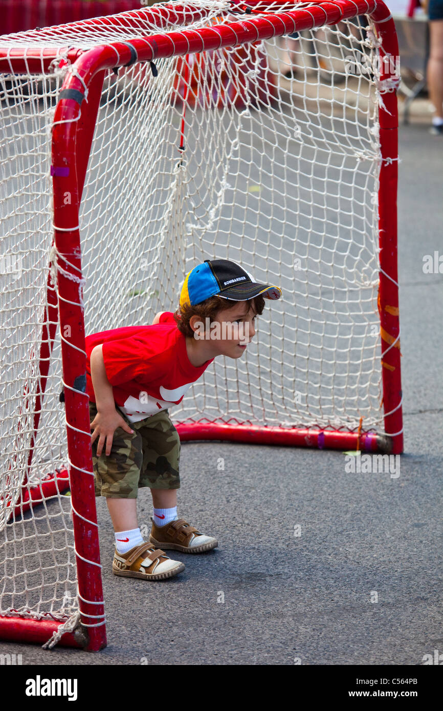 Boy playing football (soccer) in Montreal, Canada - Stock Image