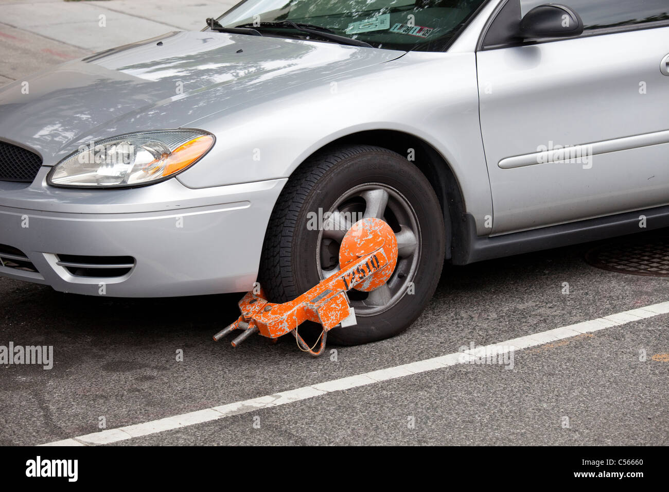 Car booted in Washington DC - Stock Image