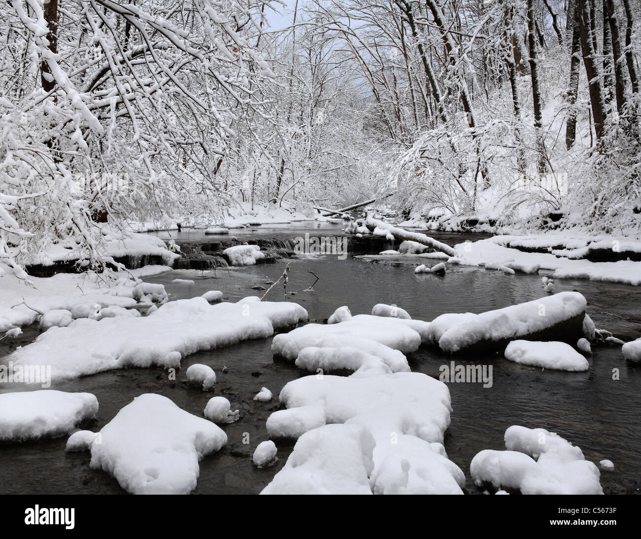 A Snow Covered Little Creek In Winter, Keehner Park, Southwestern Ohio, USA Stock Photo