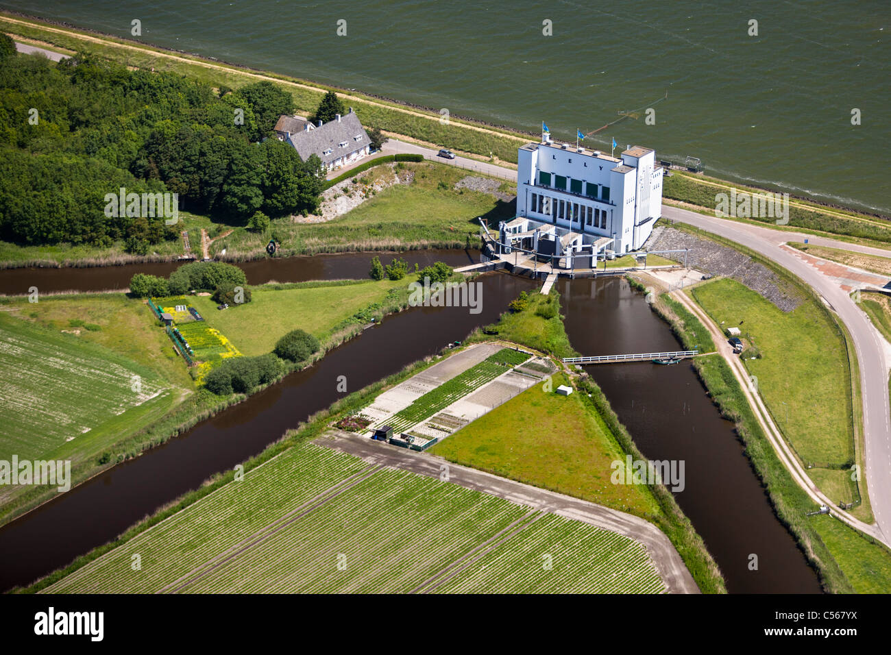 The Netherlands, Medemblik, Pumping station pumping water from polder into lake called IJsselmeer. Aerial. - Stock Image