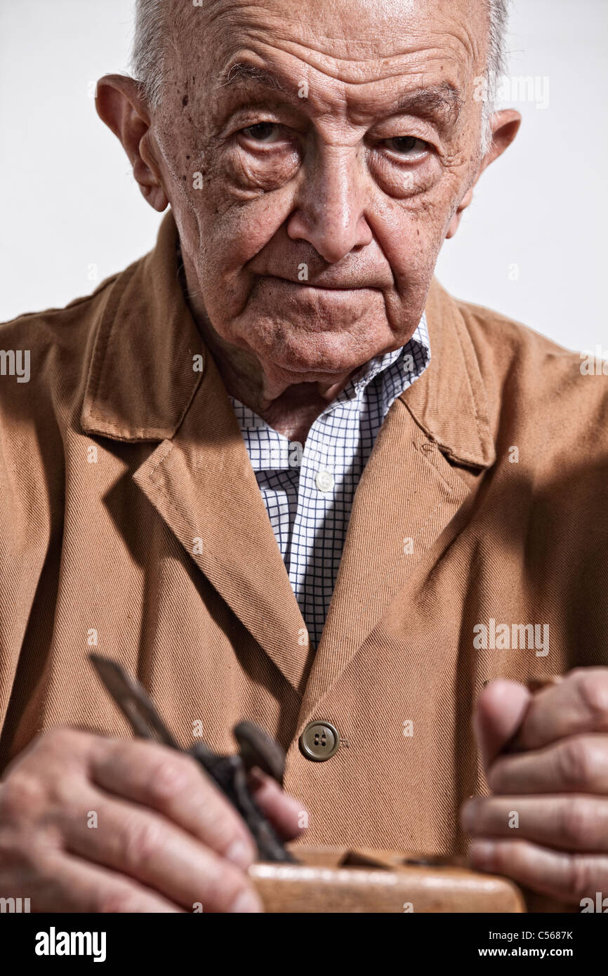 portrait of senior caucasian carpenter - Stock Image