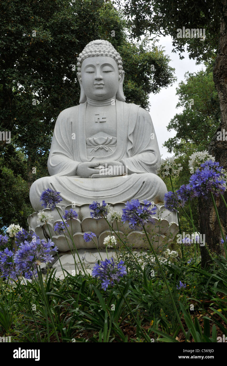 White Stone Statue Of A God Buddha Eden Garden Or Garden Of Peace