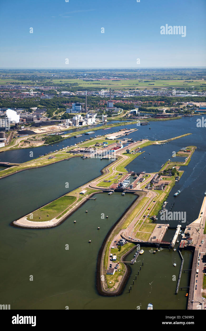 The Netherlands, IJmuiden, Aerial view of entrance and locks of North Sea Canal. Background Tata steel factory. - Stock Image
