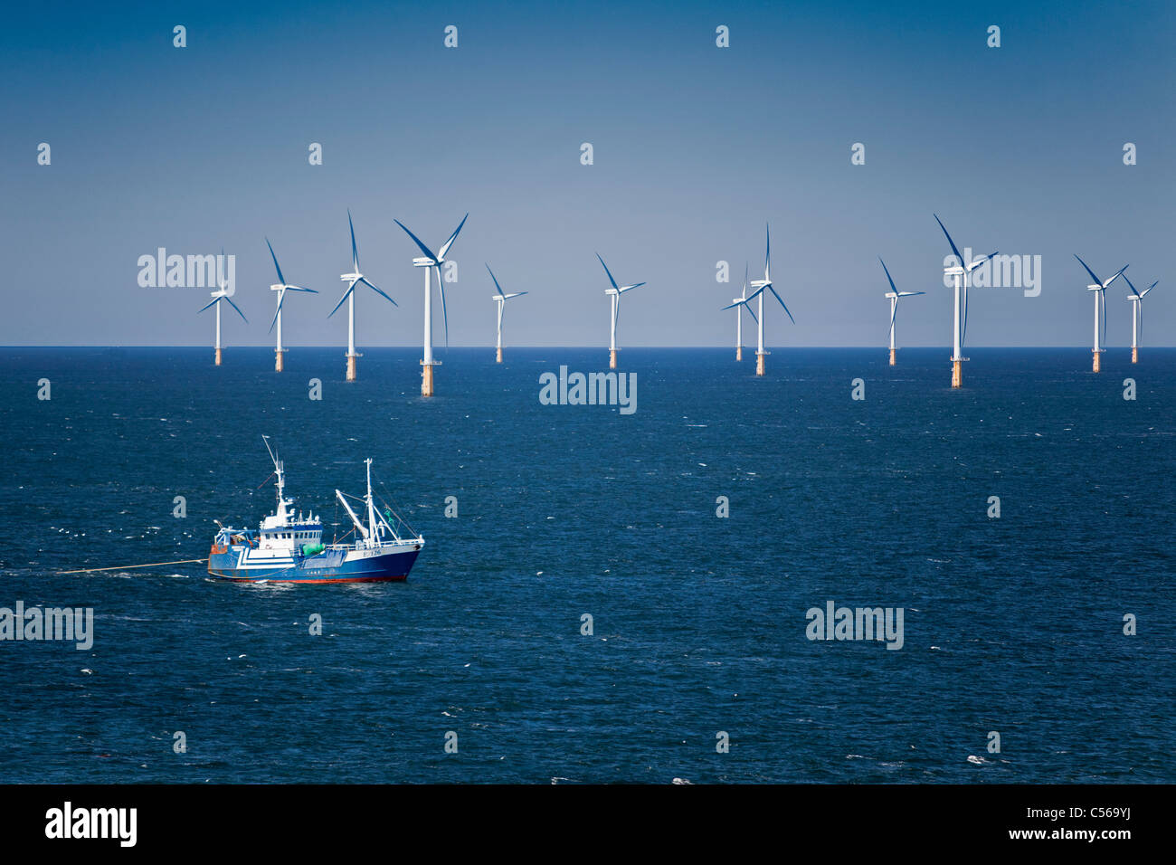 The Netherlands, IJmuiden, Wind turbines park called Offshore Windpark Egmond aan Zee or Princess Amalia. Fishing - Stock Image