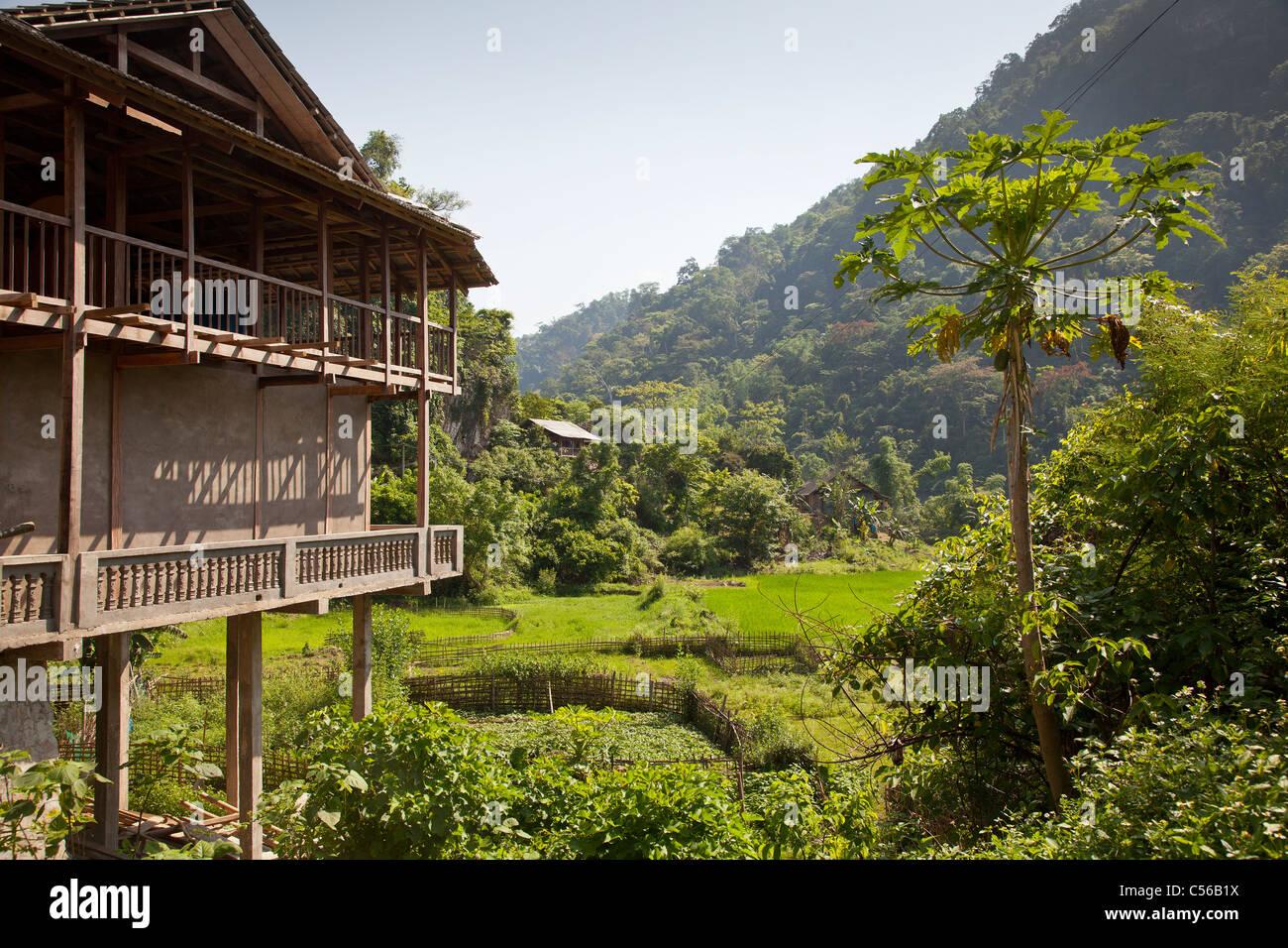 North Vietnam, hardwood farmhouse on arable farmland - Stock Image