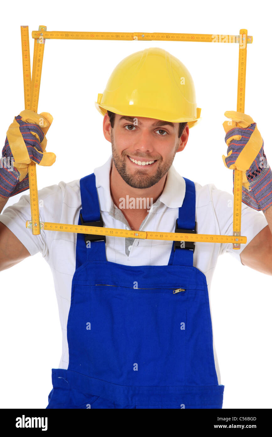 Clumsy manual worker. All on white background. - Stock Image