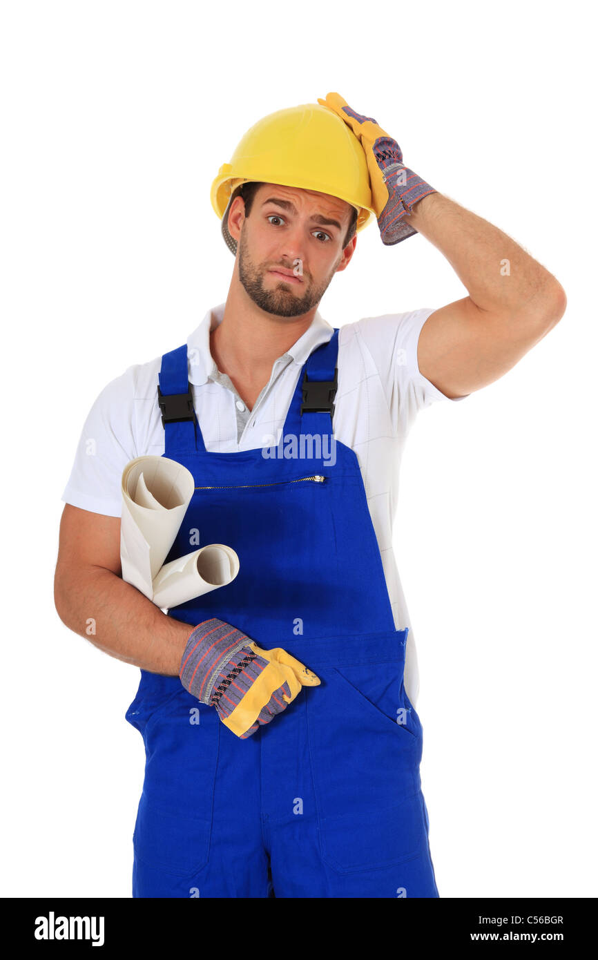 Clueless manual worker. All on white background. - Stock Image