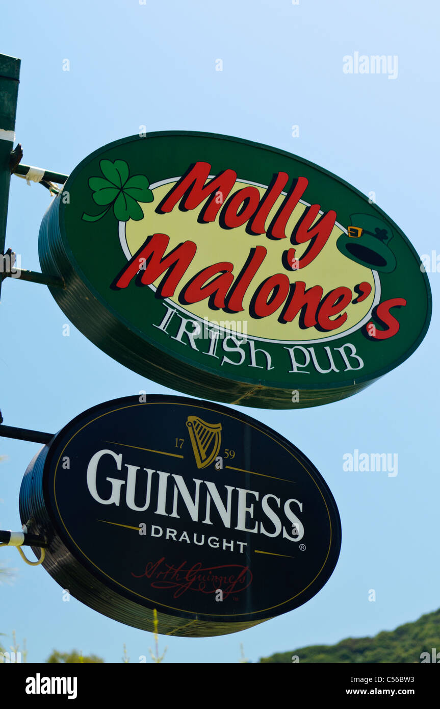 Molly Malone's Irish pub with a Guinness sign - Stock Image