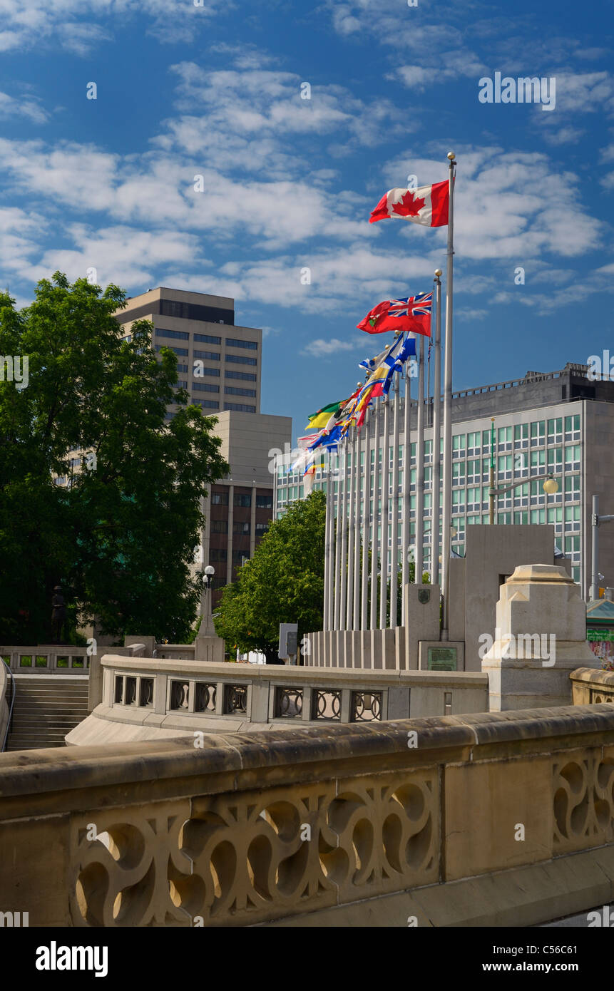 Provincial flags of Canada in downtown Ottawa from Sappers Bridge over the Rideau Canal in summer - Stock Image