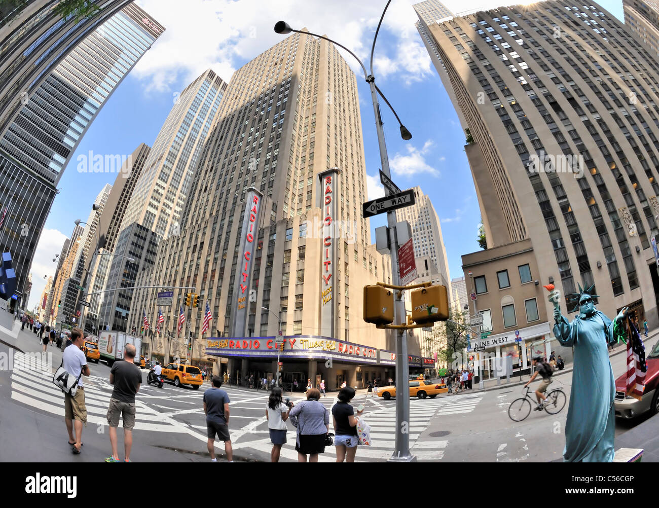 Radio City Music Hall across street, and person in Statue of Liberty costume, NYC, USA, 2011 (180 degree fisheye - Stock Image