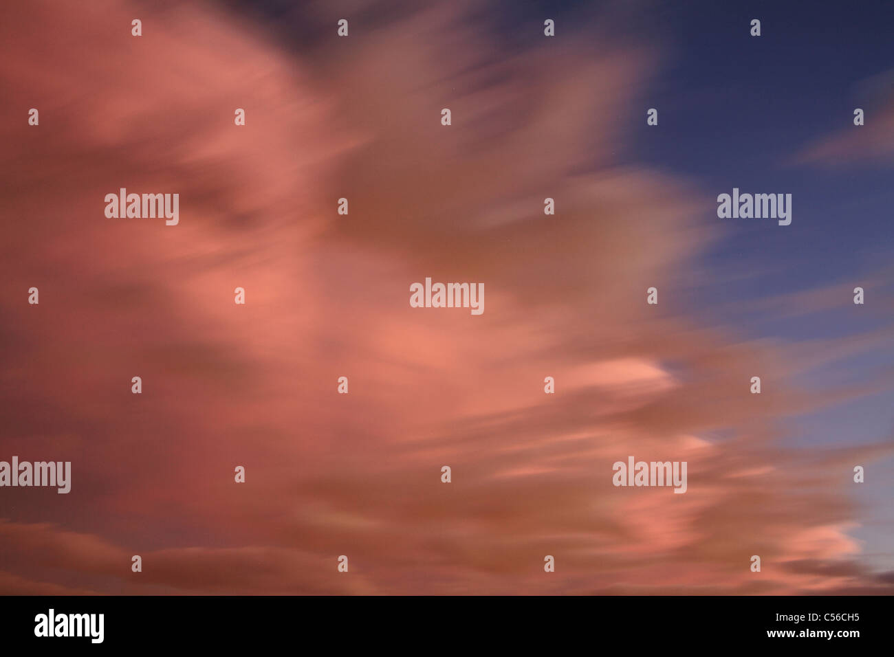 Sky And Cloud Scene, An Angry And Ominous Looking Twilight Cloudscape In Motion Blur - Stock Image