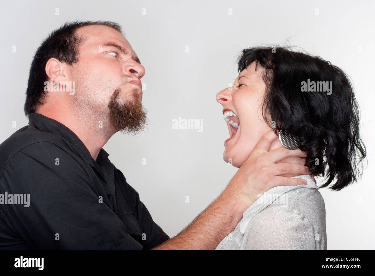couple fighting, man abusing the woman - isolated on white - Stock Image