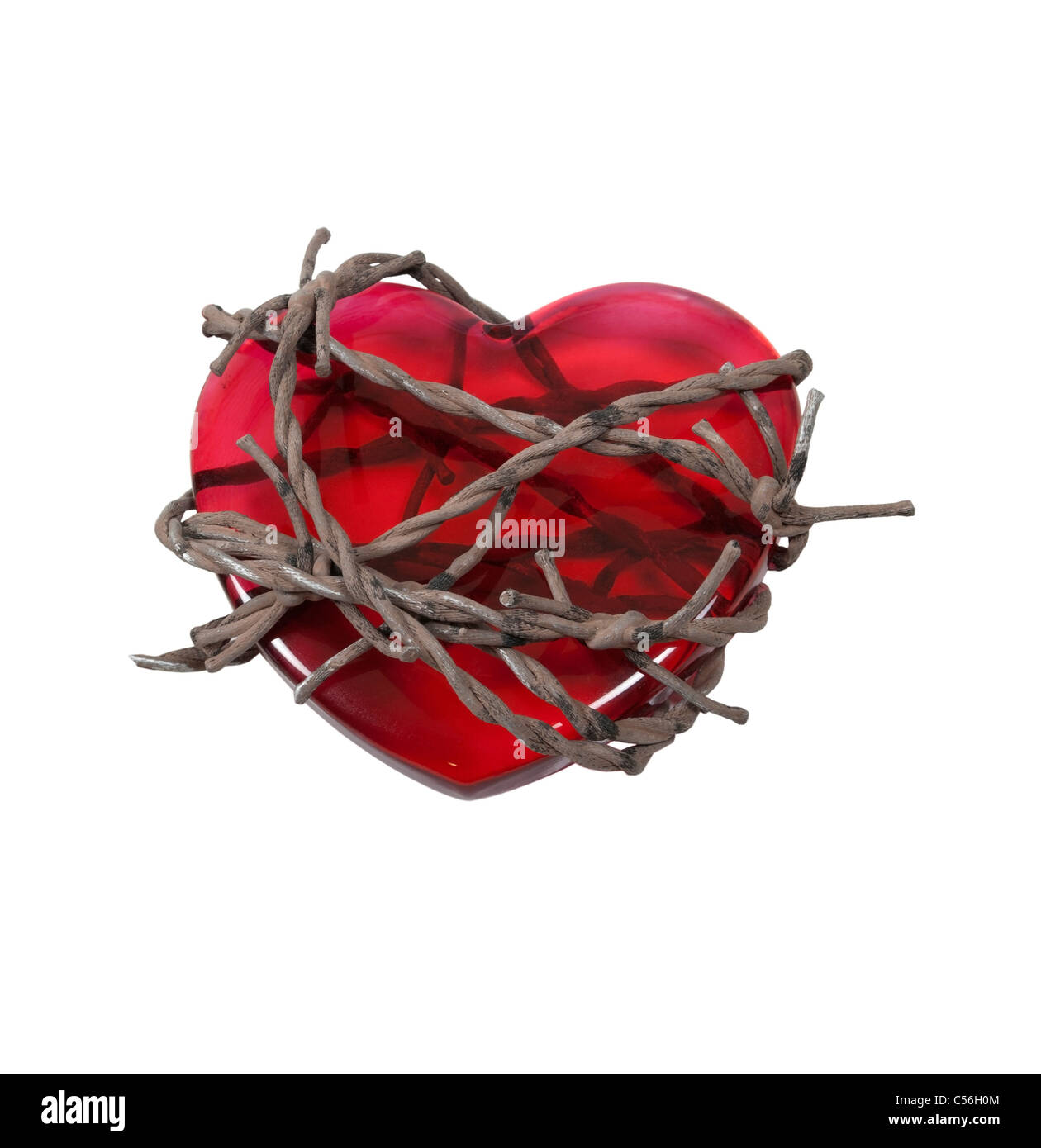 Sharp barbed wired used as a barrier bound around a red heart - path included - Stock Image