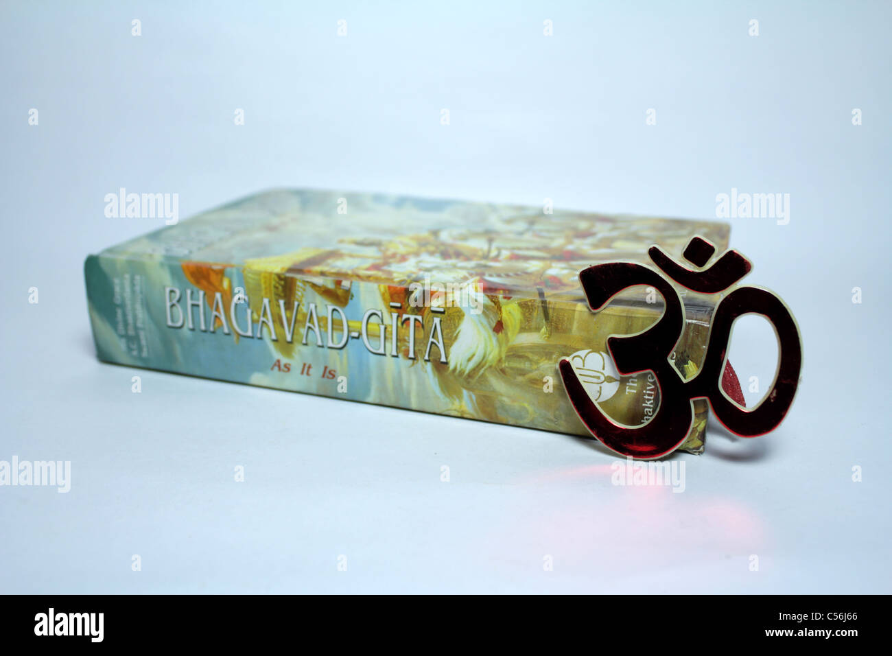 The holy book of Hindus; The Bhagvad Gita and the Hindu symbol OM - Stock Image