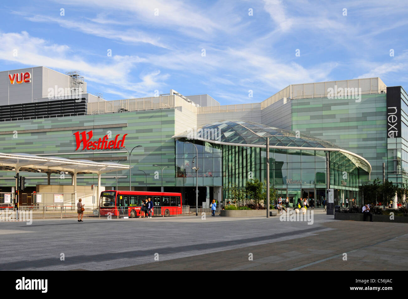 Modern architecture at Westfield Shepherds Bush shopping centre business & part of White City public transport bus Stock Photo