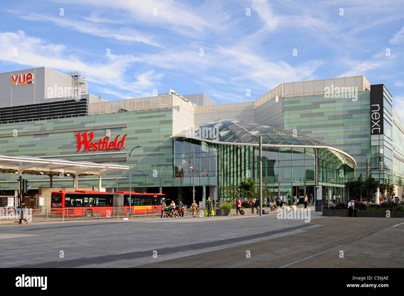 """Westfield shopping centre and part of adjoining """"White City"""" bus station including Vue cinema and Next clothing Stock Photo"""