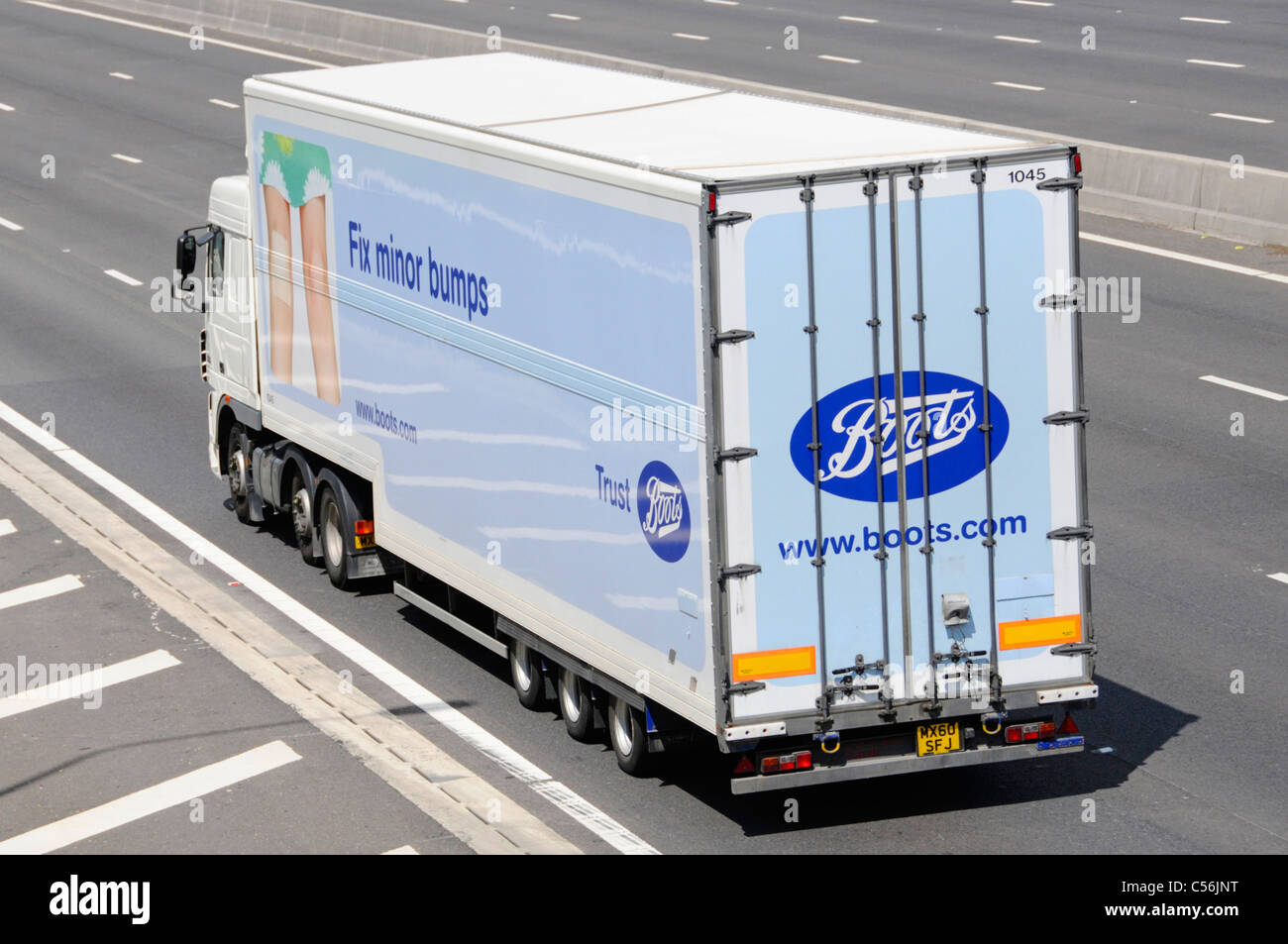Side & back view Boots pharmacy chemist business hgv supply chain lorry truck & trailer with graphics advertising - Stock Image