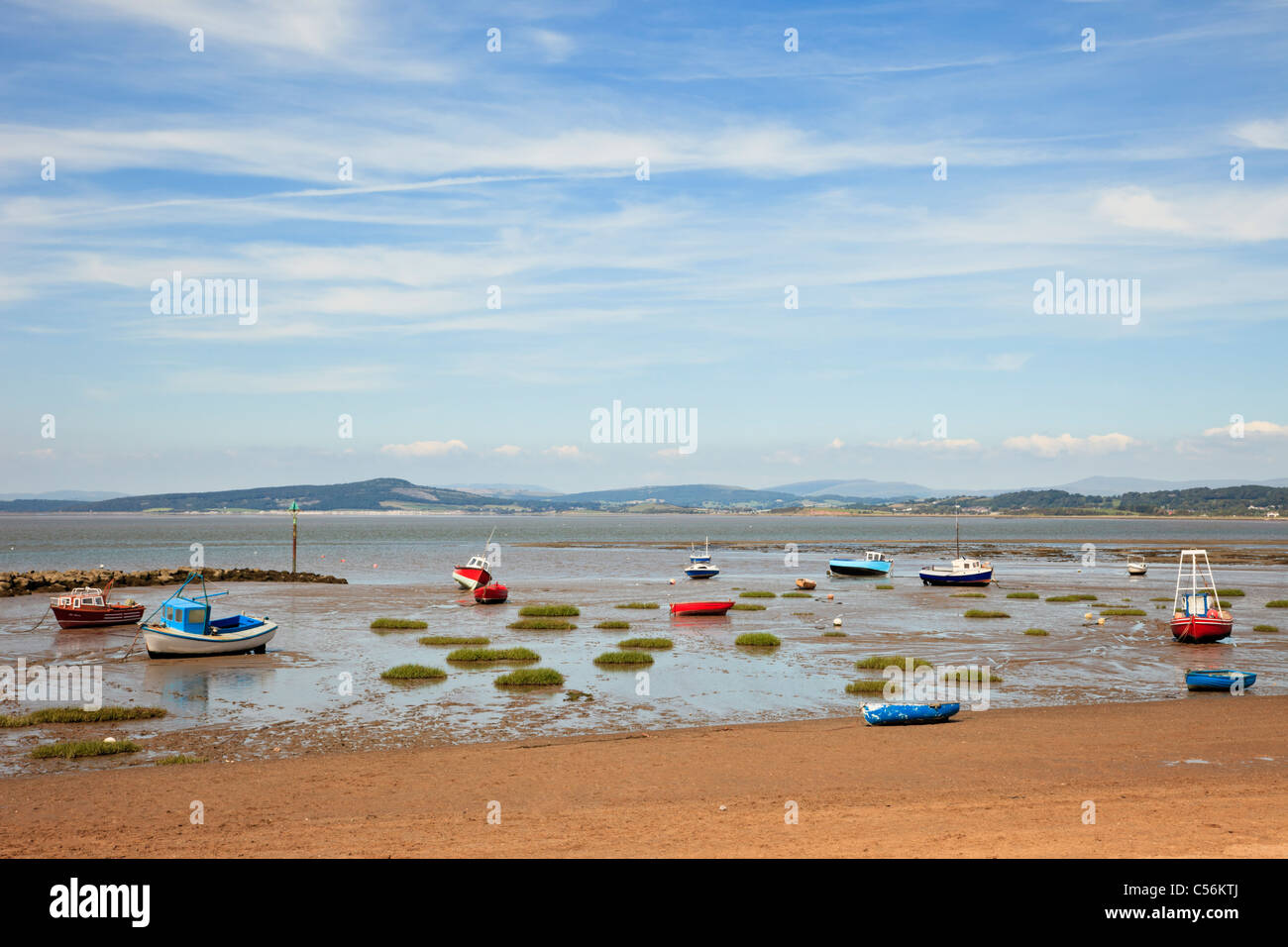 Beached boats on the sands at low tide with view across Morecambe Bay on north west coast. Morecambe Bay, Lancashire, - Stock Image