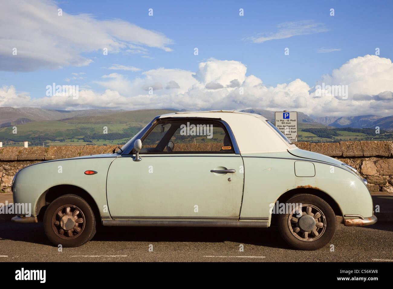 Green retro styled Nissan Figaro automatic soft top coupe sports car ...