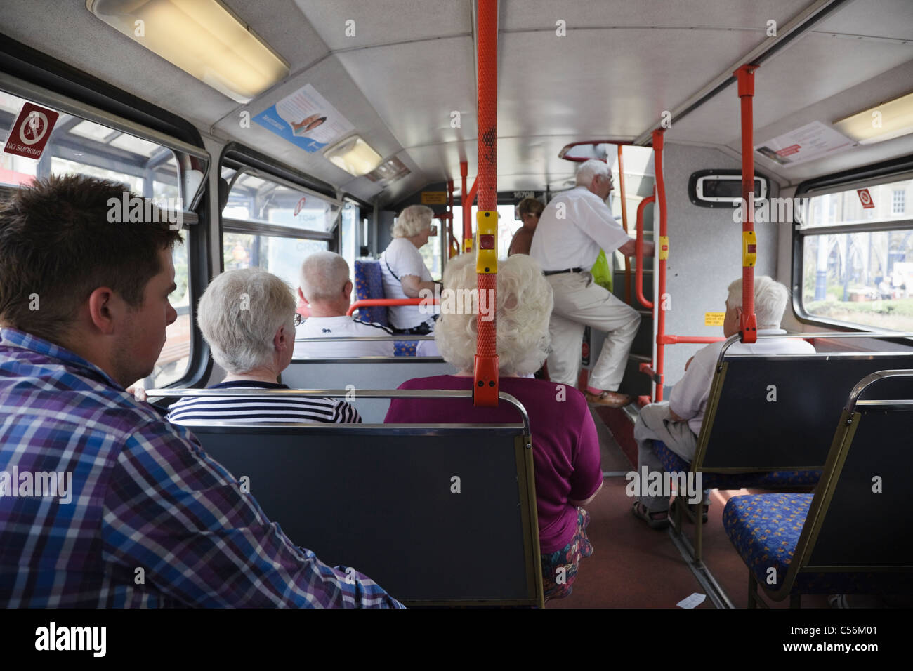 People passengers using public transport travelling on a local bus. England, UK, Britain - Stock Image