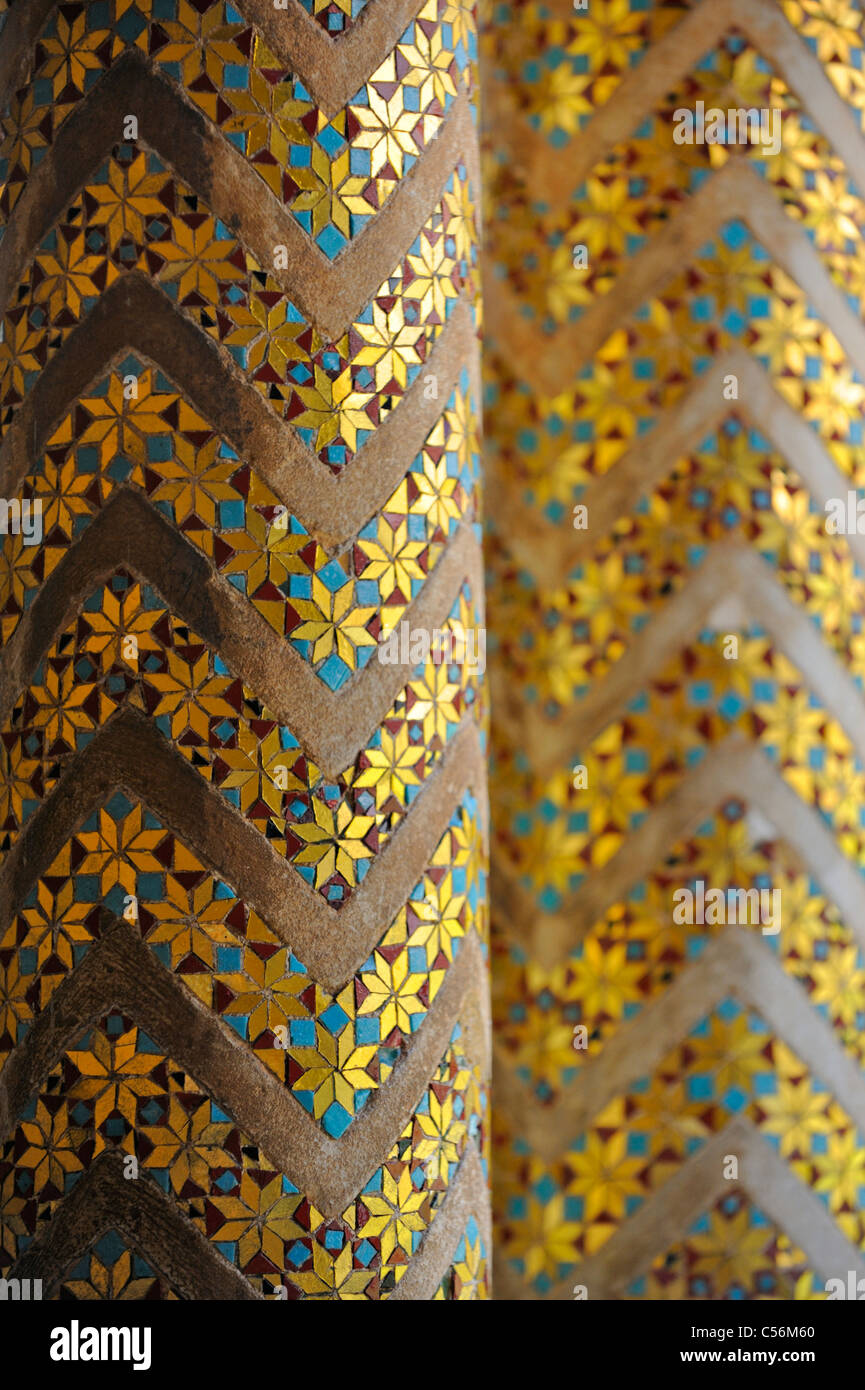 A pair of columns with richly guilded mosaic inserts in the cloister at Monreale - Stock Image