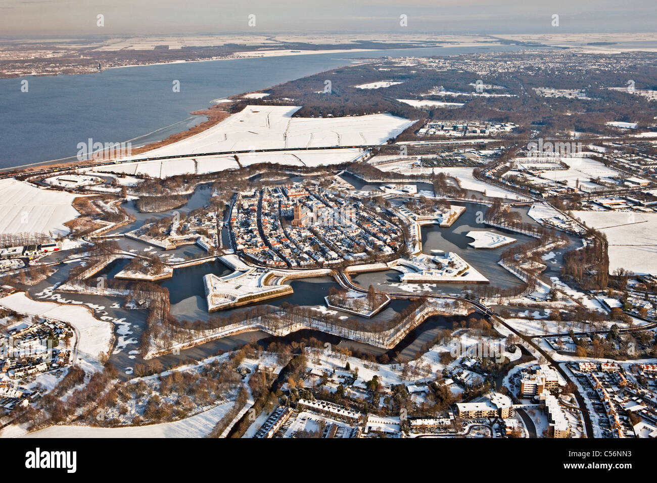 The Netherlands, Fortified star shaped city of Naarden. Aerial. Snow. - Stock Image