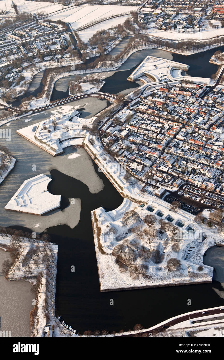 The Netherlands, Fortified star shaped city of Naarden. Aerial. Snow - Stock Image
